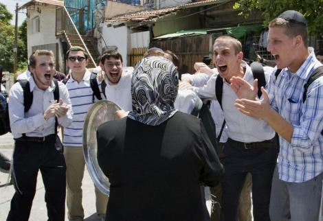 Settlers jeer at a Palestinian woman after occupation authorities force her out of her home in the Sheikh Jarrah neighborhood in Jerusalem